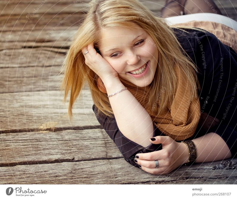 Human being Youth (Young adults) Beautiful Adults Feminine Warmth Laughter Lie Young woman Happiness 18 - 30 years Smiling Joie de vivre (Vitality) Positive