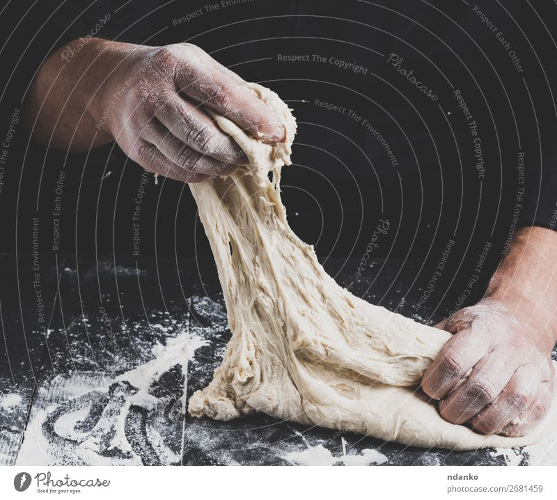 male hands substitute white wheat flour dough Man White Hand Black Adults Wood Nutrition Kitchen Baked goods Tradition Cooking Bread Make Meal Baking Dough