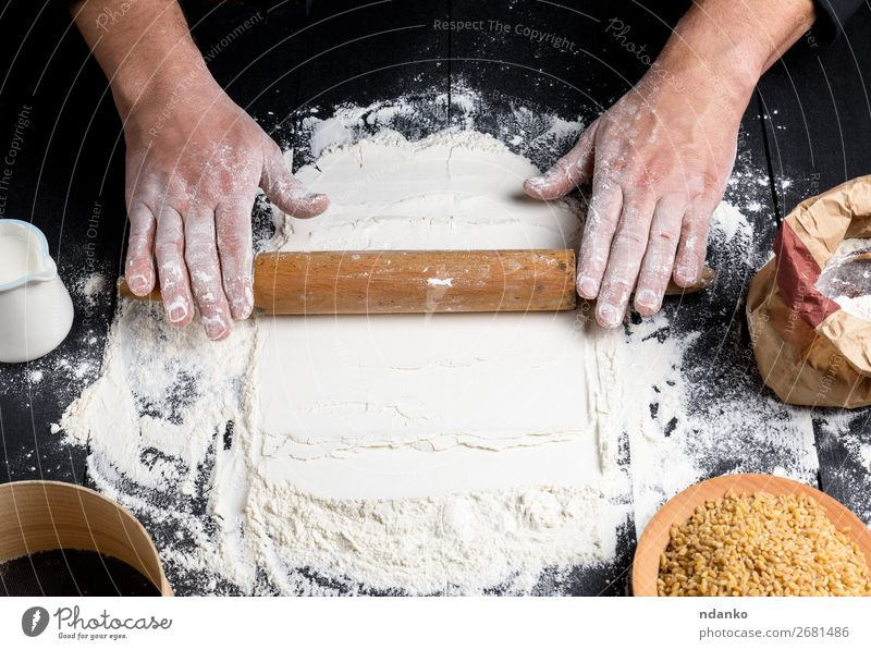 process of making dough by male hands Dough Baked goods Bread Table Kitchen Human being Hand 30 - 45 years Adults Sieve Make Black White rolling Pizza Flour pin