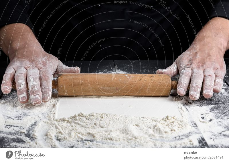 wooden rolling pin in male hands Dough Baked goods Bread Table Kitchen Cook Human being Hand Make Black White Pizza Flour Bakery cooking food Home-made