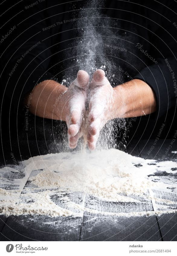 man's hands and splash of white wheat flour Dough Baked goods Bread Table Kitchen Human being Hand 30 - 45 years Adults Wood Make Dark Black White Bakery board