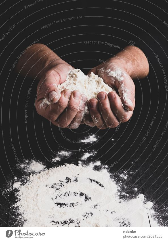 white wheat flour in male hands, black background Dough Baked goods Bread Table Kitchen Human being Hand Wood Make Dark Black White Flour Pizza Bakery Home-made