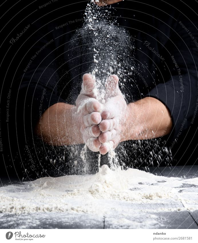 man's hands and splash of white wheat flour Dough Baked goods Bread Table Kitchen Cook Human being Hand Wood Make Dark Black White Splash Flour Pizza Bakery