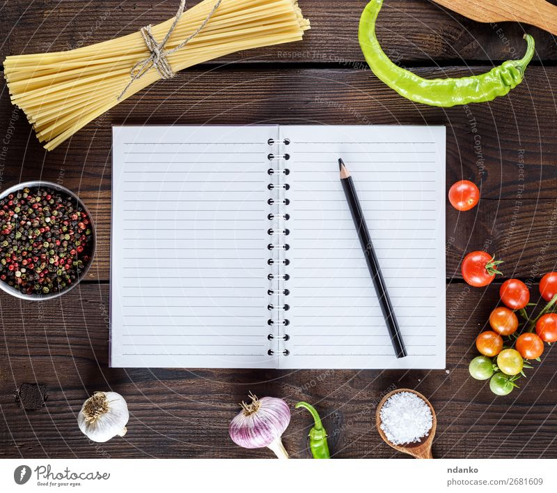blank notebook with white sheets, raw long paste Dough Baked goods Herbs and spices Nutrition Vegetarian diet Table Kitchen Book Leaf Paper Wood Fresh Natural