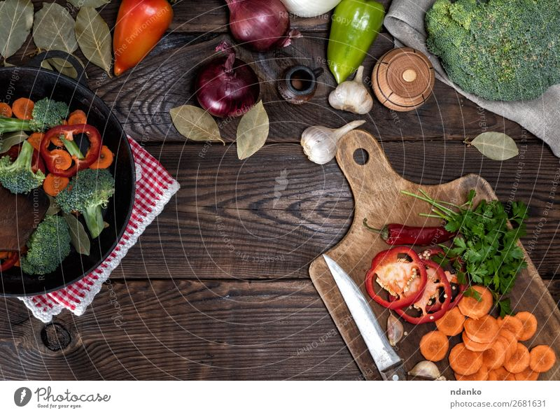 fresh pieces of carrots, broccoli and red pepper Vegetable Herbs and spices Nutrition Eating Vegetarian diet Diet Pan Fork Table Kitchen Nature Plant Wood Fresh
