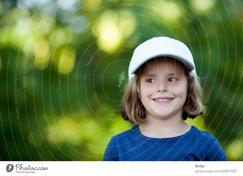 Little cute girl with a cap in the park Joy Happy Beautiful Face Life Relaxation Leisure and hobbies Vacation & Travel Freedom Camping Summer Child Human being