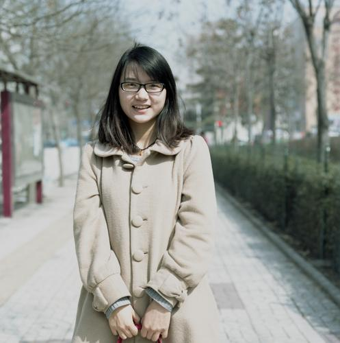 Estella. Human being Feminine Young woman Youth (Young adults) 1 Beijing Town Downtown Breathe To hold on Smiling Stand Wait Beautiful Moody Contentment