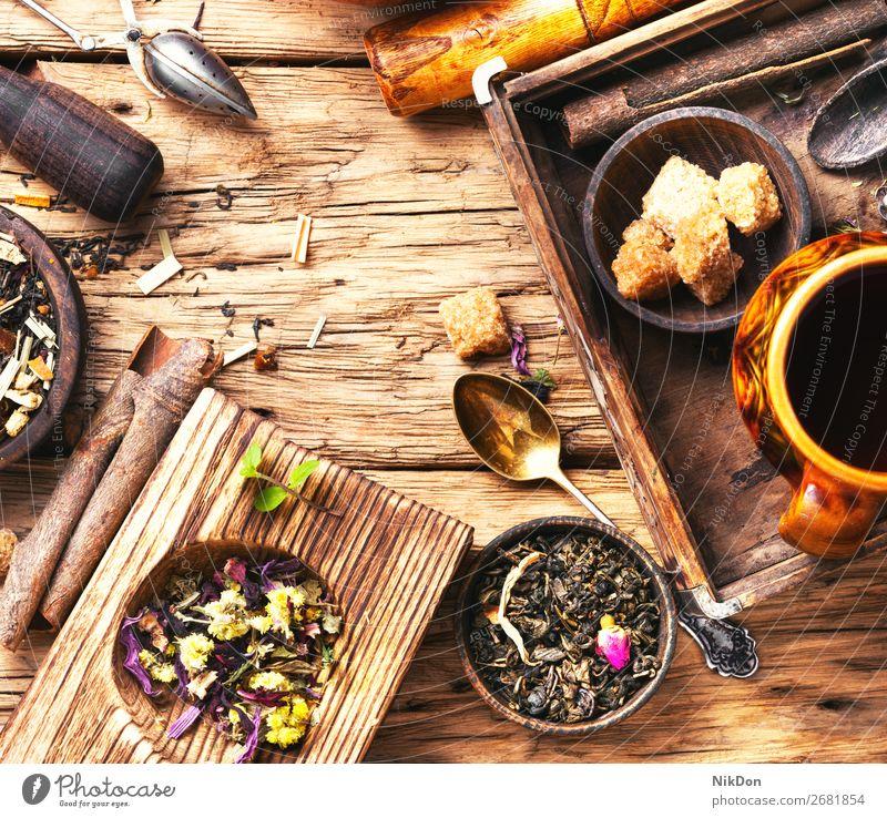 leaves of herbal tea leaf drink cup healthy natural antioxidant bowl sugar cinnamon spice rustic retro dry black aromatic heap freshness fruit tea leaves petal