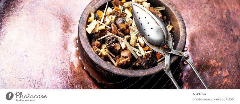 tea leaf in wooden pot drink healthy herb natural antioxidant chinese organic closeup dry herbal black aromatic heap freshness crop tea leaves petal spoon