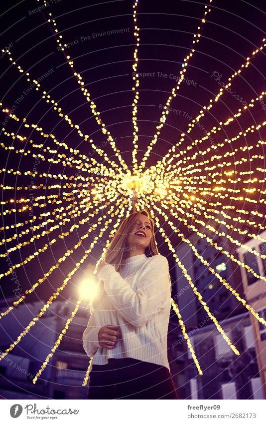 Young woman enjoying Christmas lights in Vigo Lifestyle Shopping Joy Leisure and hobbies Christmas decoration Christmas fairy lights Christmas & Advent