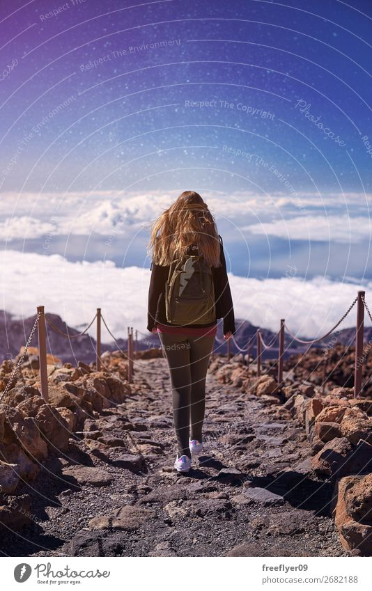 Woman walking on Teide Mountain, with the stars in the sky Lifestyle Wellness Harmonious Hiking Feminine Young woman Youth (Young adults) 1 Human being
