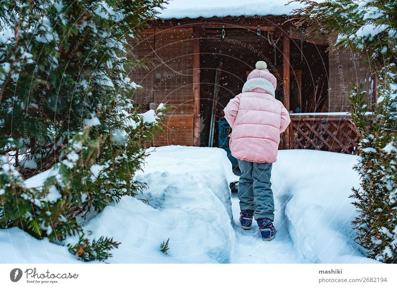 kid girl helping to clean pathway from snow with shovel Playing Winter Snow House (Residential Structure) Garden Child Tool Weather Storm Snowfall Happiness