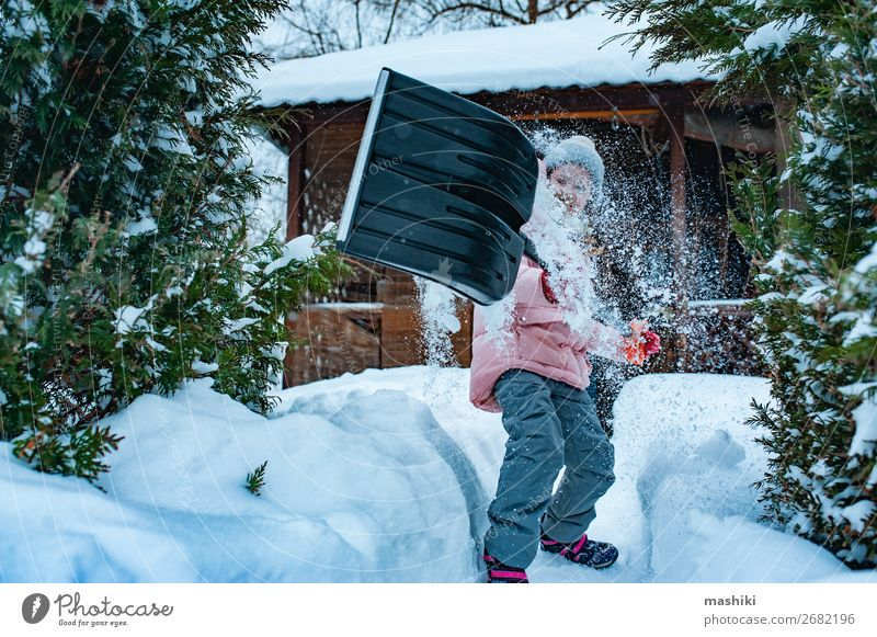 kid girl helping to clean pathway from snow with shovel. Playing Winter Snow House (Residential Structure) Garden Child Tool Weather Storm Snowfall Happiness