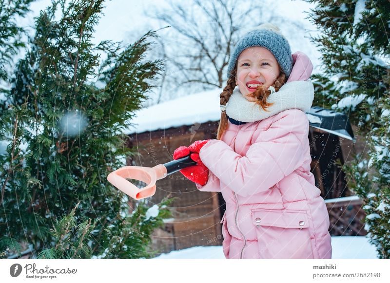 kid girl helping to clean pathway from snow with showel Playing Winter Snow House (Residential Structure) Garden Child Work and employment Tool Weather Storm