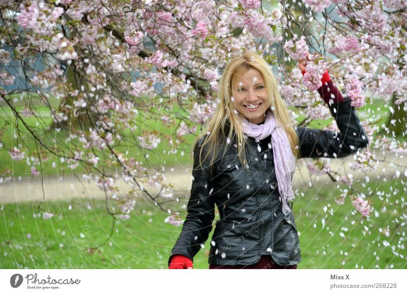 snow Human being Feminine Woman Adults 1 18 - 30 years Youth (Young adults) Nature Spring Tree Leaf Blossom Garden Park Blonde Long-haired Smiling Laughter