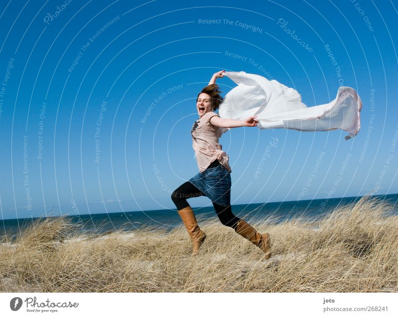 free as the wind when it blows Young woman Youth (Young adults) Dance Horizon Summer Ocean Movement Flying To enjoy Laughter Walking Jump Illuminate Dream Happy