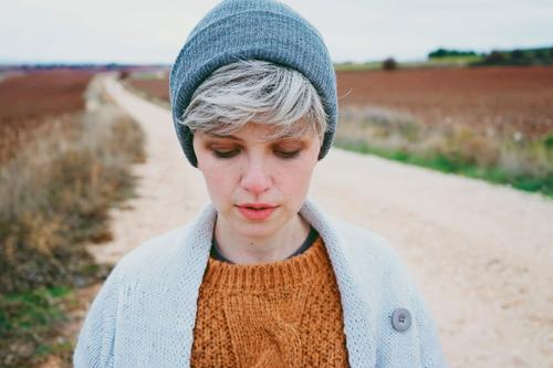 Woman with short and gray hair alone outdoors Human being Youth (Young adults) Young woman Landscape Clouds Loneliness Winter Face Lifestyle Adults Autumn