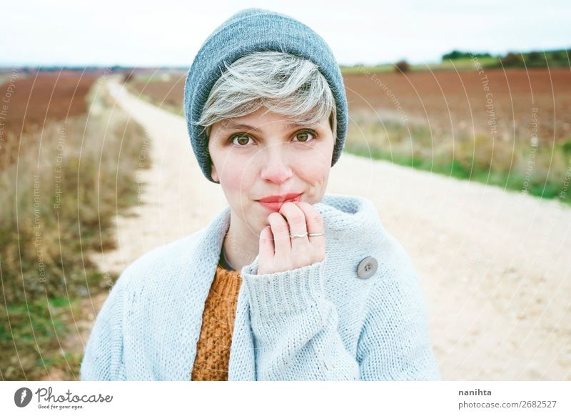 Woman with short and gray hair alone in a path Human being Youth (Young adults) Beautiful Landscape Clouds Loneliness Joy Winter Far-off places 18 - 30 years
