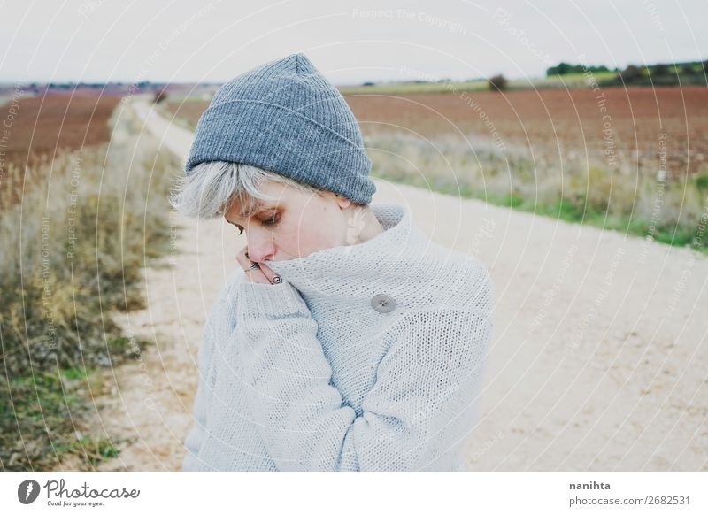 Woman with short and gray hair in a path Human being Youth (Young adults) Young woman Landscape Relaxation Clouds Loneliness Calm Winter Far-off places