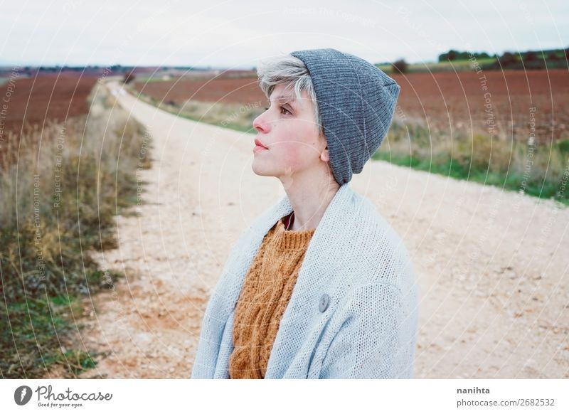 Woman with short and gray hair is alone in a path Lifestyle Style Skin Face Wellness Well-being Senses Relaxation Adventure Far-off places Freedom Winter