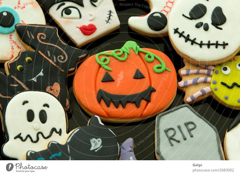 Halloween cookies with different shapes Dessert Plate Joy Face Decoration Table Feasts & Celebrations Hallowe'en Autumn Cat Wood Smiling Creepy Delicious Brown