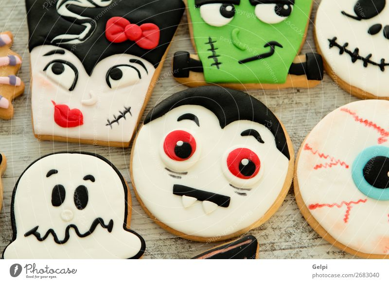 Halloween cookies with different shapes Dessert Joy Face Decoration Table Feasts & Celebrations Hallowe'en Autumn Wood Smiling Creepy Delicious Brown Black