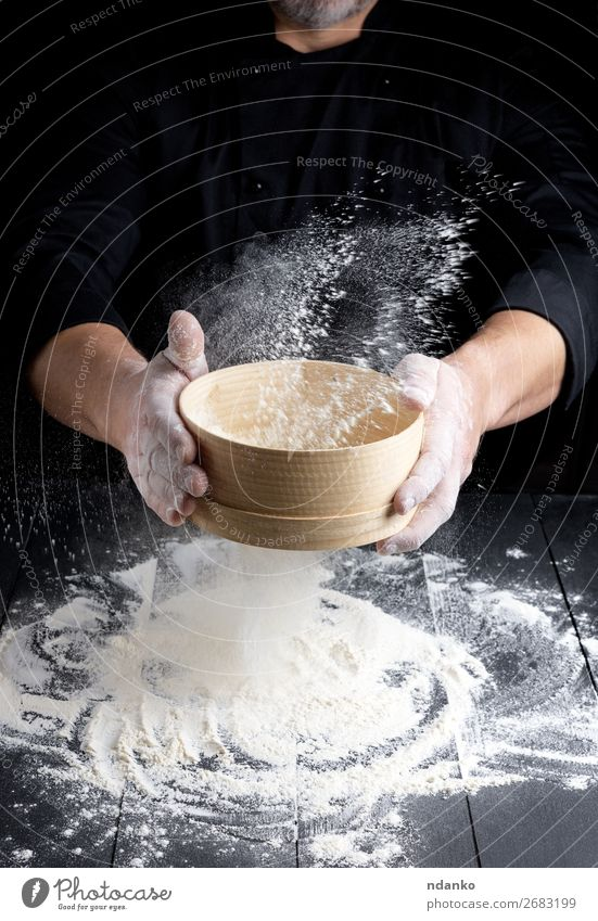 wooden sieve with flour in male hands Dough Baked goods Bread Nutrition Table Kitchen Cook Human being Man Adults Hand 30 - 45 years Sieve Wood Movement Make