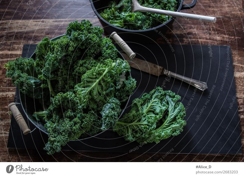 Prepare kale for cooking top view Food Vegetable Lettuce Salad Kale Kale leaf Cabbage Organic produce Vegetarian diet Diet Fasting Bowl Pot Knives Spoon
