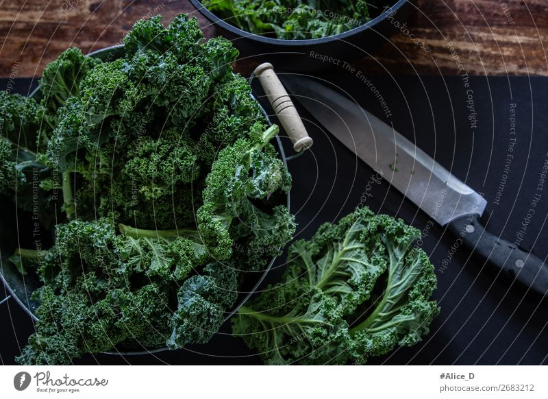 Fresh kale on cutting board Food Vegetable Lettuce Salad Cabbage Kale Kale leaf Nutrition Organic produce Vegetarian diet Diet Bowl Knives Lifestyle Healthy