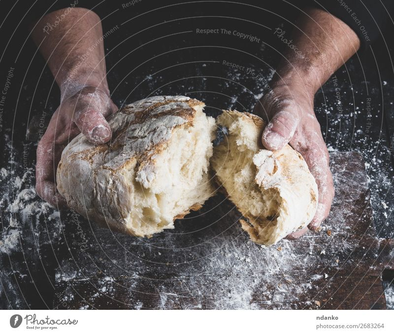 broken white bread in male hands Bread Nutrition Table Kitchen Cook Human being Hand Fingers Wood Make Dark Fresh Brown Black White Tradition Baking Baker