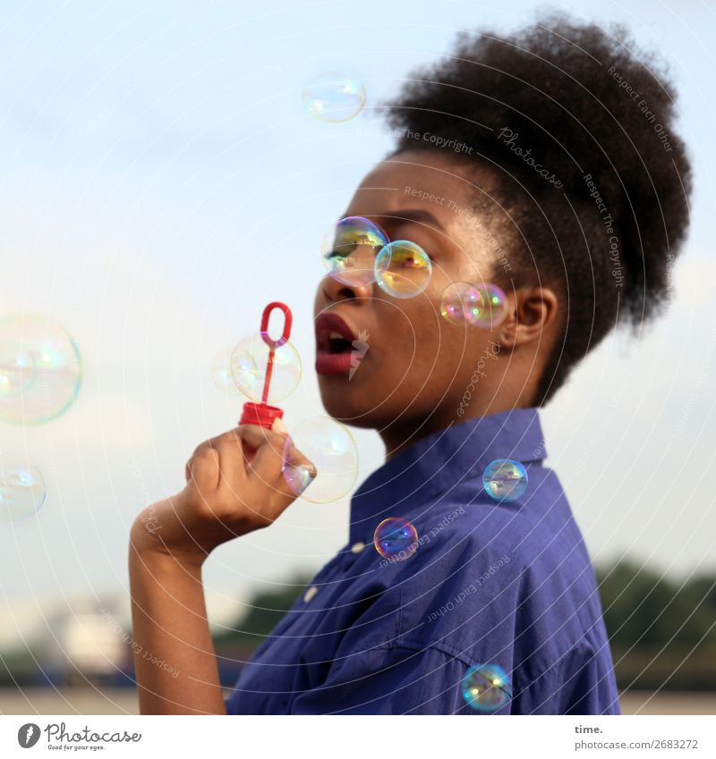 seriousbubbles Feminine Woman Adults 1 Human being Sky Horizon Beautiful weather Shirt Black-haired Long-haired Afro Soap bubble Observe To hold on To enjoy