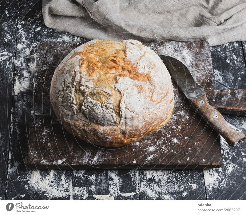 whole baked round white wheat bread Bread Knives Table Kitchen Wood Eating Make Dark Fresh Brown Black White Tradition loaf Baking Bakery board cooking