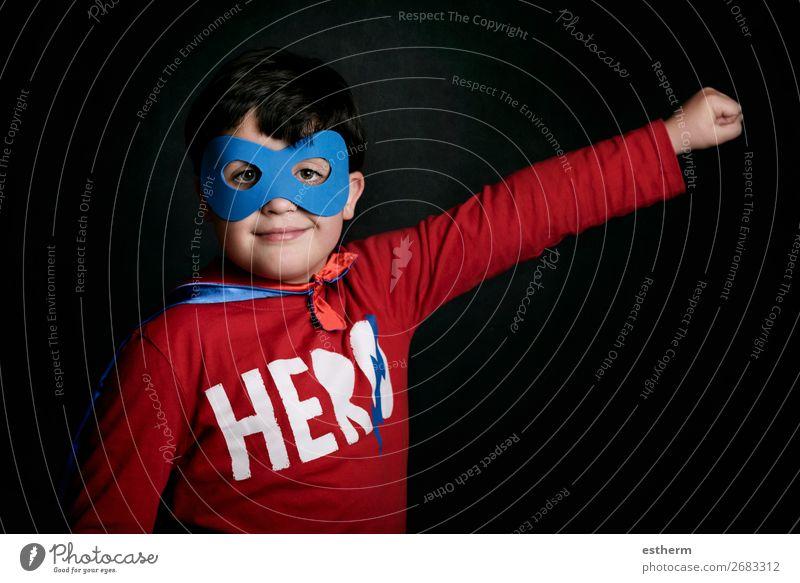 Portrait of boy in superhero costume on black background Lifestyle Joy Playing Adventure Freedom Feasts & Celebrations Fairs & Carnivals Birthday Success