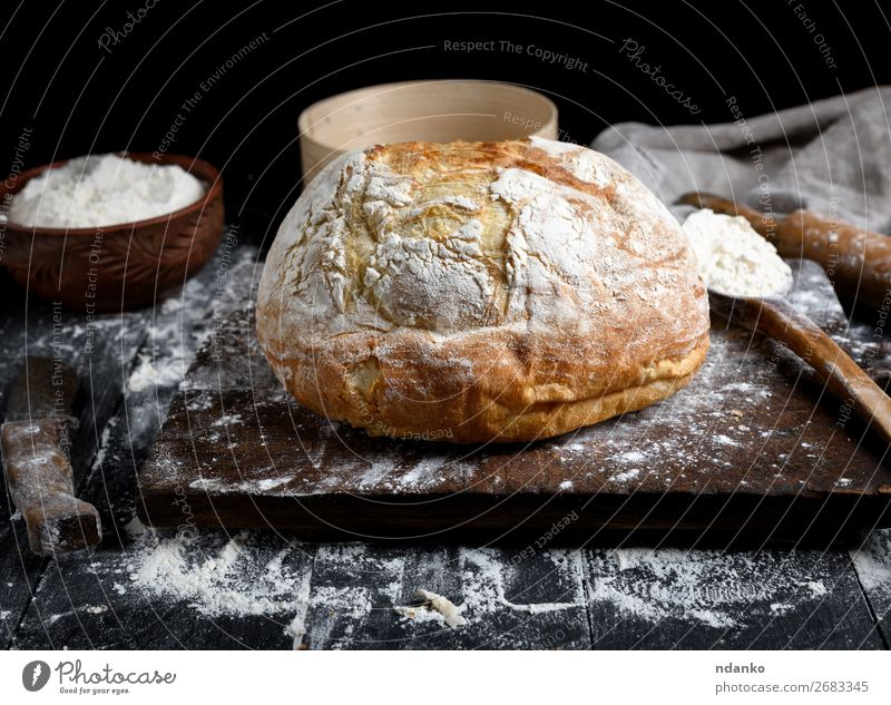 baked round white wheat bread Dough Baked goods Bread Bowl Spoon Table Kitchen Sieve Wood Make Dark Fresh Brown Black White Tradition Chopping board cooking