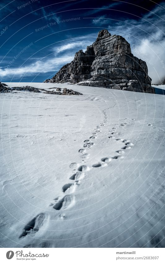 Footprints for dirndling from the Dachstein group Snow Winter vacation Mountain Hiking Climbing Mountaineering Nature Landscape Beautiful weather Rock Alps Peak