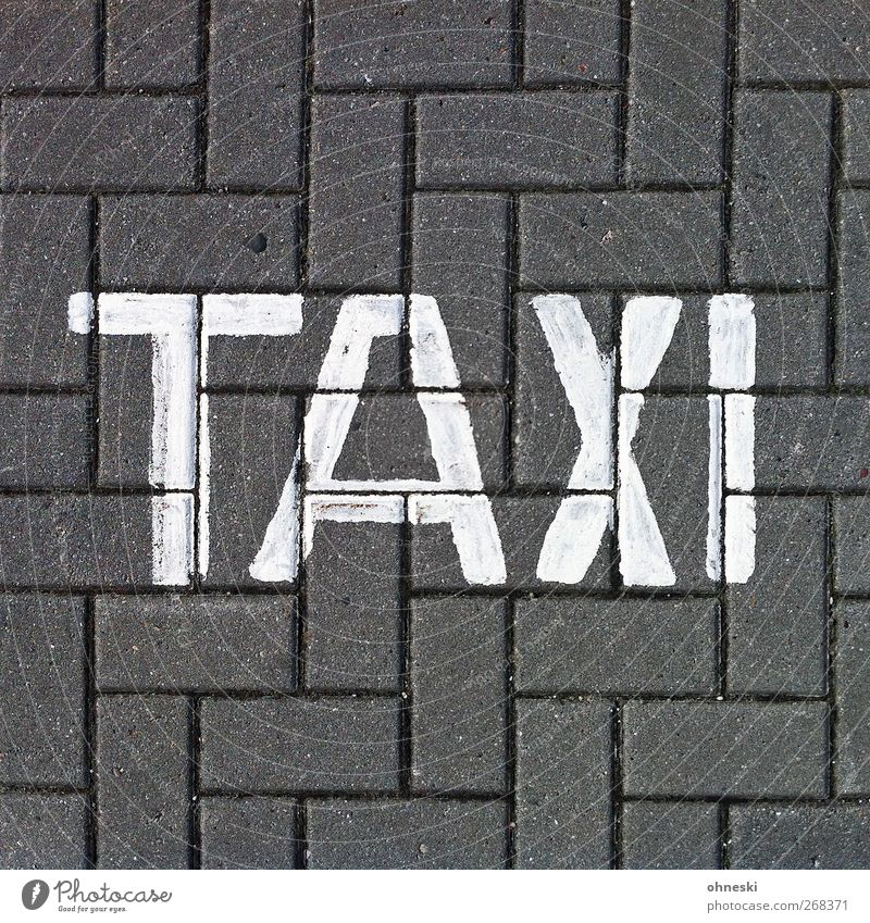...to Paris Means of transport Passenger traffic Motoring Street Taxi Stone Sign Characters Signs and labeling Driving Colour photo Subdued colour Exterior shot
