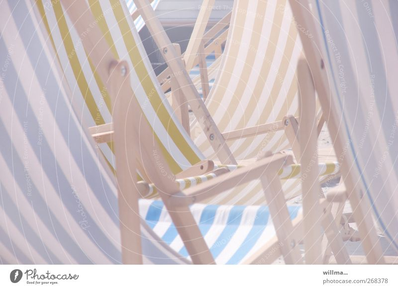 Empty deck chairs in the sun Beach Deckchair Relaxation Bright Leisure and hobbies Boredom Striped Pastel tone Warmth Deserted deckchairs Lifestyle