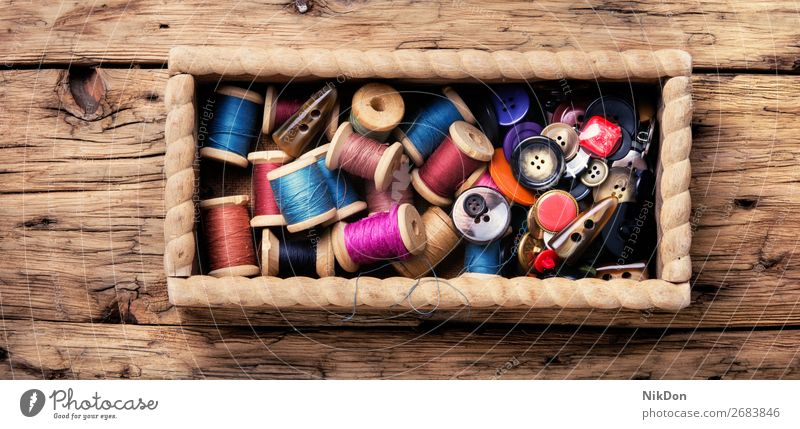 Thread spools and buttons thread sewing textile cloth craft fashion tailor needlework colorful clothing closeup fabric hobby tool old bobbin handmade accessory