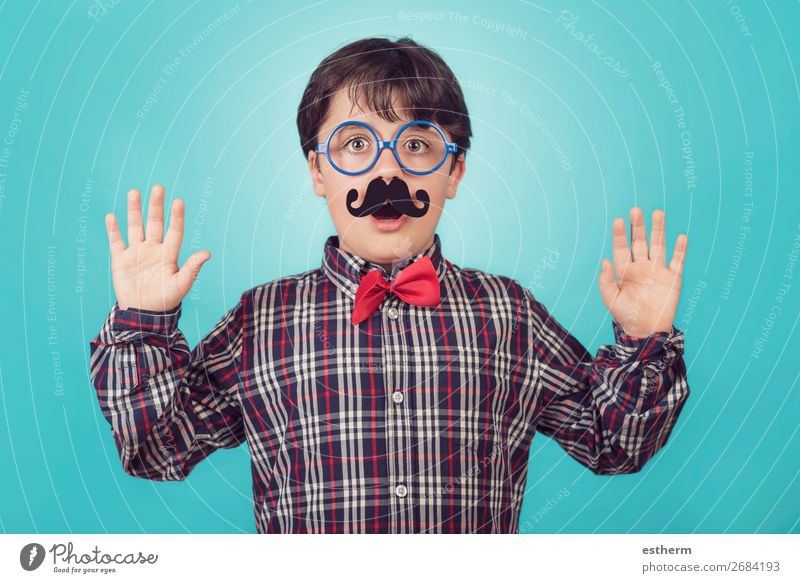 Funny boy with fake mustache and tie Child Human being Blue Joy Lifestyle Adults Emotions Movement Feasts & Celebrations Boy (child) Masculine Smiling Birthday