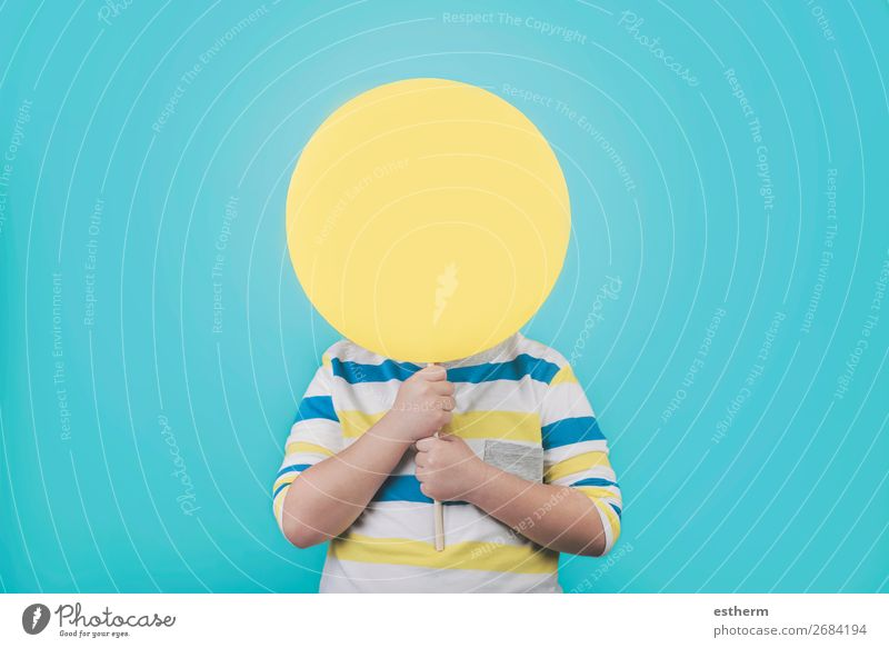 Boy holding a yellow sign Lifestyle To talk Human being Masculine Child Toddler Infancy 1 8 - 13 years Sign Signs and labeling Sphere Movement To hold on