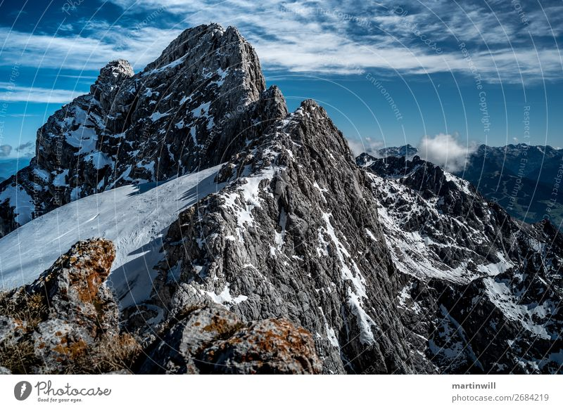 Mountain ridge for dirndling in the Dachstein group Hiking Beautiful weather Rock Alps Peak Wall of rock Vantage point Clouds Peak cross Colour photo