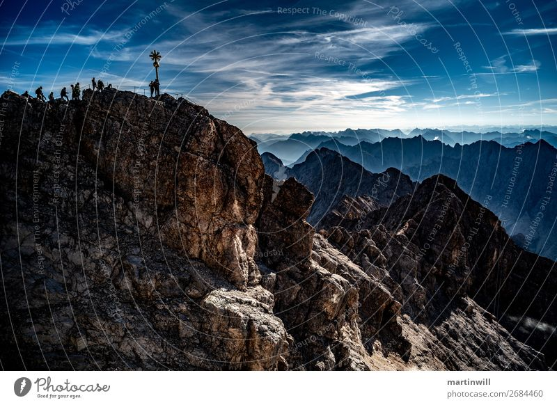 Visitors to the summit of Zugspitze Mountain Hiking Climbing Mountaineering Landscape Sky Beautiful weather Rock Alps Peak Peak cross mountain ranges