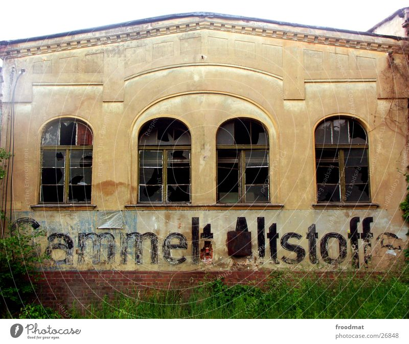 Collects waste materials ! East Derelict Arch Typography Window Broken Historic Characters GDR Old