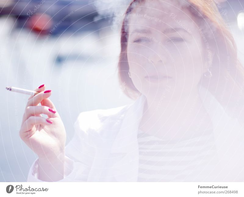 Taking a cigarette break I. Young woman Youth (Young adults) Woman Adults Head Hand Fingers 1 Human being 18 - 30 years Relaxation Cigarette Cigarette smoke
