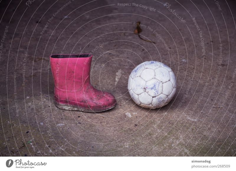 boycott? Ball Boots Rubber boots Dirty Round Pink Infancy Asphalt Kick off Stagnating Colour photo Exterior shot Deserted Copy Space top Copy Space bottom
