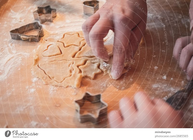 Christmas biscuits cut out Food Dough Baked goods Nutrition cut out cookies Flour Star (Symbol) Chopping board Kitchen Human being Hand Fragrance