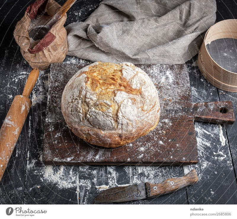baked bread Dough Baked goods Bread Knives Spoon Table Kitchen Sieve Wood Make Dark Fresh Above Brown Black White Tradition recipe Preparation Baking Bakery