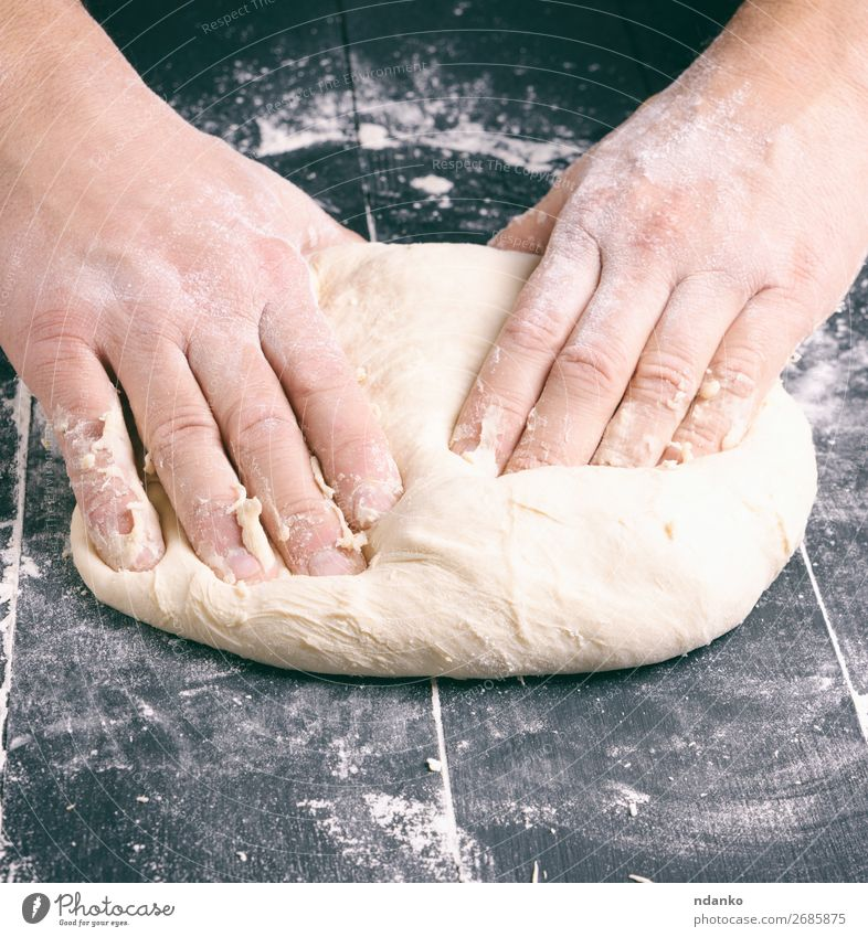male hands substitute white wheat flour dough Dough Baked goods Bread Nutrition Table Kitchen Man Adults Hand Wood Make Black White Tradition Baking Baker
