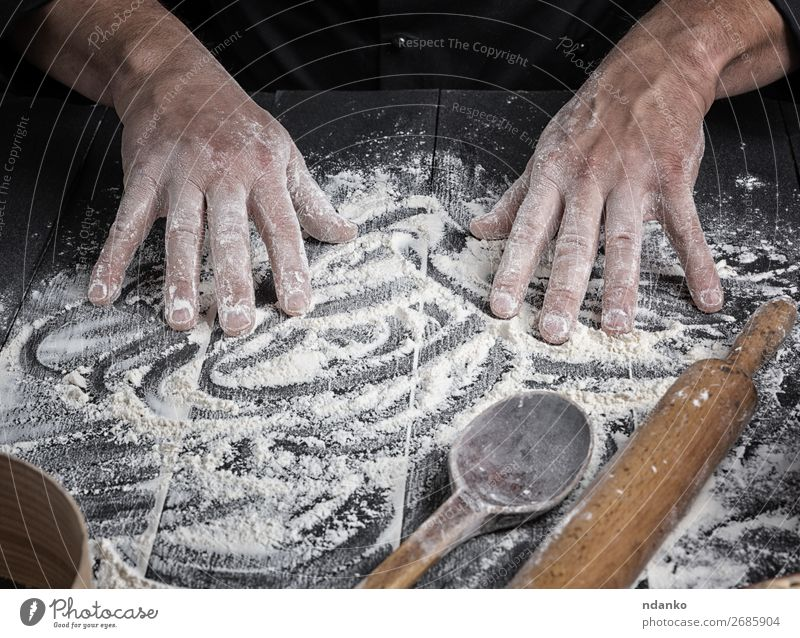 men's hands stir the white wheat flour Human being Man White Hand Dark Black Adults Wood Work and employment Fresh Table Kitchen Baked goods Cooking Bread Make