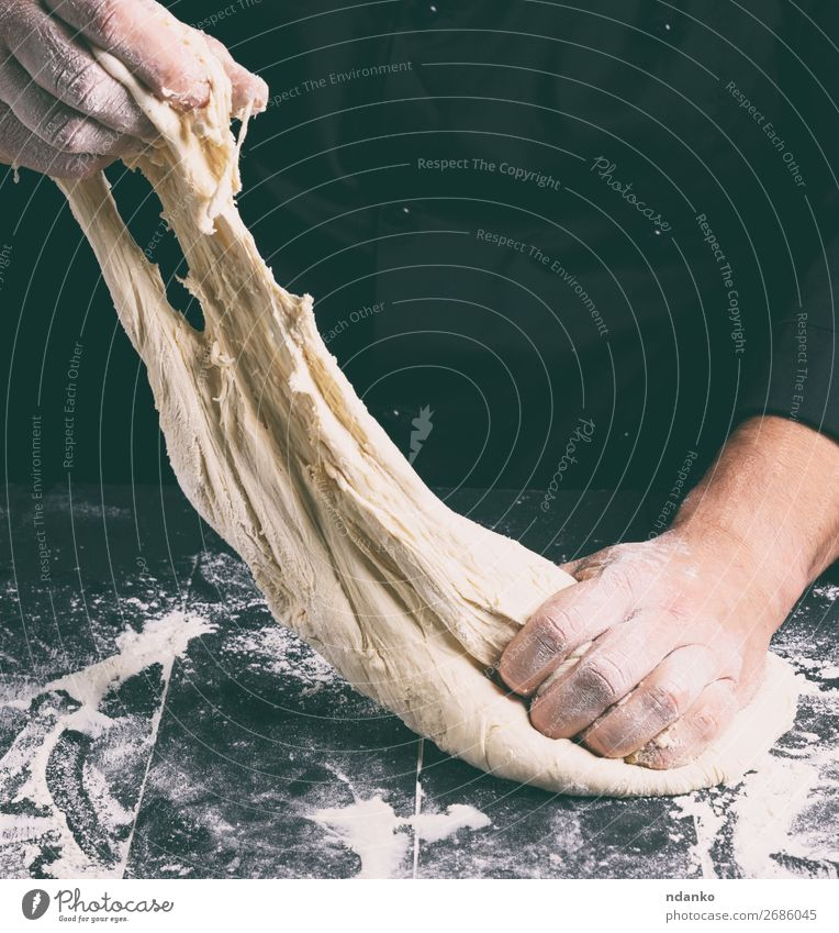 male hands substitute white wheat flour dough Human being Man White Hand Black Adults Nutrition Table Kitchen Baked goods Tradition Cooking Bread Make Hang Meal